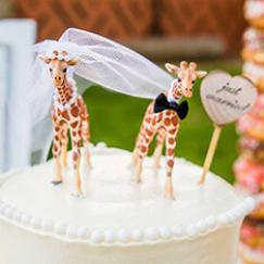 Giraffe wedding cake toppers.