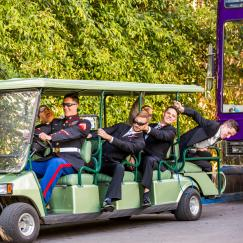 groomsmen clowning on cart